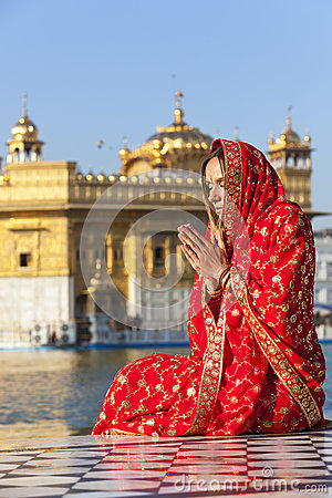 Lady in red sari at the Golden Temple.