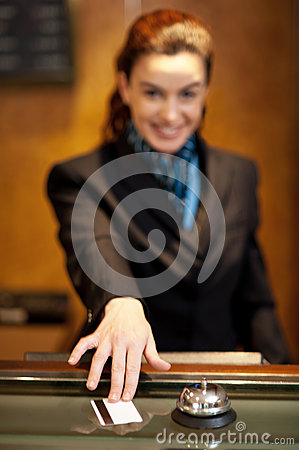 Lady returning the cash card to the customer