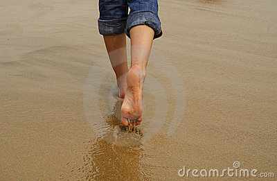 Lady s feet walking on sand