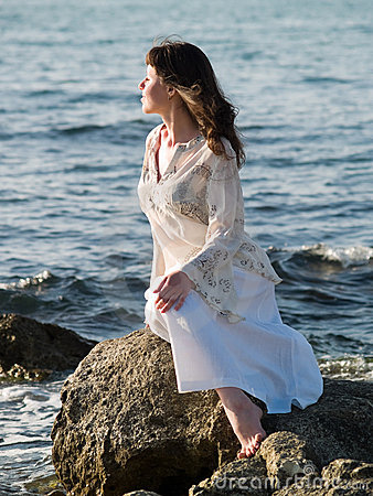 Free Lady Sitting On Sea Rock Royalty Free Stock Photography - 5424537