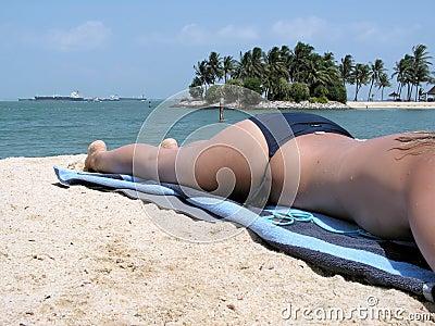 Lady topless sunbathing