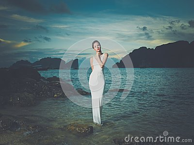 Lady in white dress on a seashore