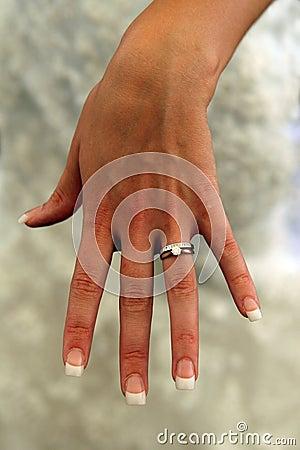 Lady in white revealing wedding ring