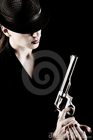 Free Lady With A Revolver Royalty Free Stock Image - 20111826