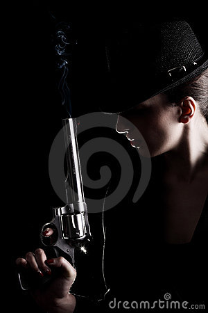 Free Lady With A Revolver Royalty Free Stock Photography - 20112007