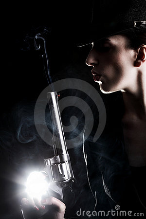 Free Lady With A Revolver Royalty Free Stock Photos - 20112038