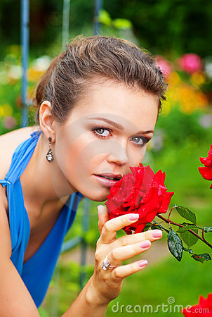 Free Lady With Rose In Garden Stock Images - 15524484