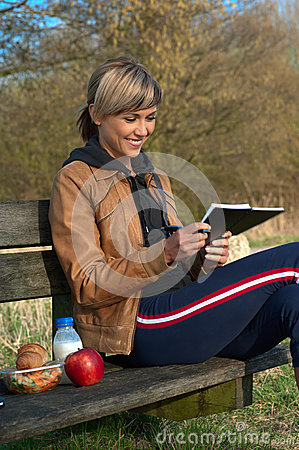 Lady Writing Outdoors