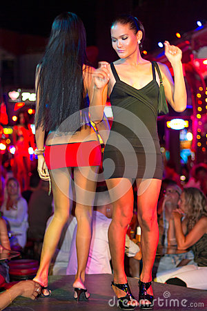 Ladyboys dancing on the street of Patong, Thailand Editorial Stock Image