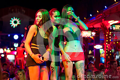 Ladyboys on the street of Patong at night Editorial Image