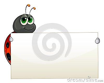 A ladybug holding an empty signage