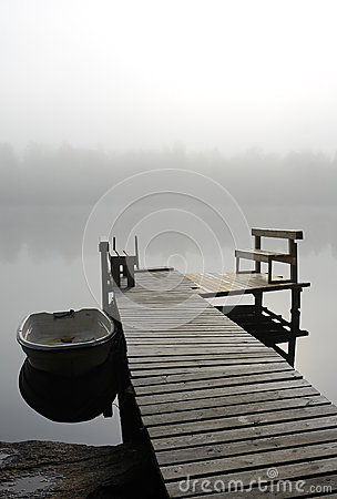Lake bridge in foggy morning