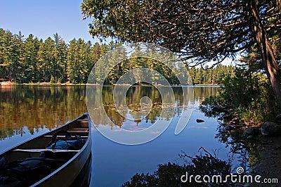 Lake and canoe