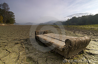 A lake  dries up during a drought.