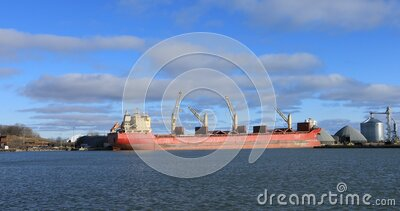 Lake freighter in harbour at Oshawa, Ontario, Canada 4K. A Lake freighter in harbour at Oshawa, Ontario, Canada 4K stock footage