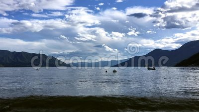 Lake maggiore in the evening after sunset with fisherman on the boat stock footage