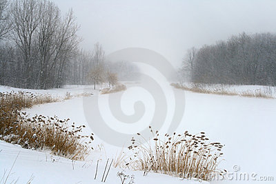 Lake in misty haze of winter blizzard