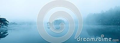 Lake in the misty rain