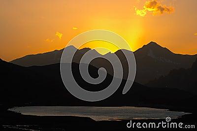 Lake and mountain sunset