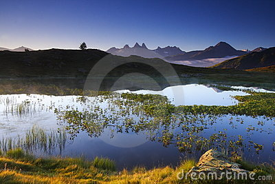 Lake and mountains at dawn, france