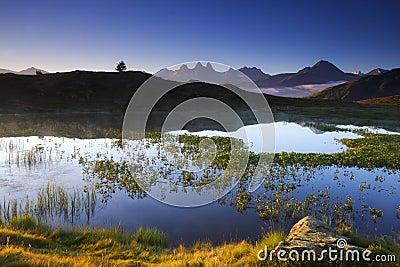 Lake and mountains at dawn, france