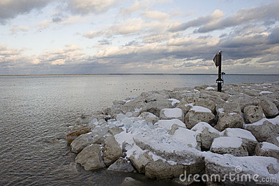 Lake snow covered rocks 1