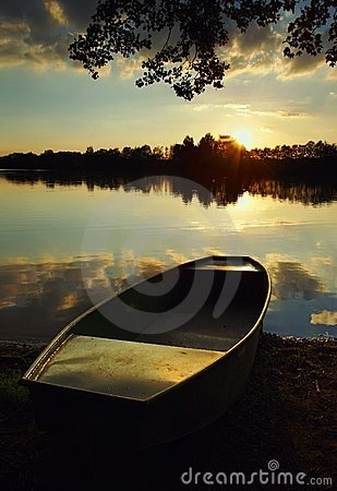 Lake at Sunset with a Boat