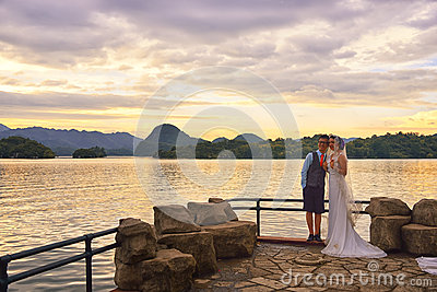 Lake Sunset and  wedding couple Editorial Image
