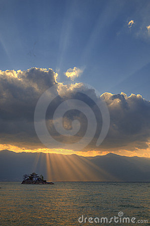 Lakes - the temple - sun - clouds