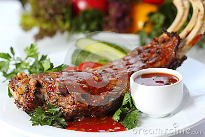 Lamb chops with greens and garnish