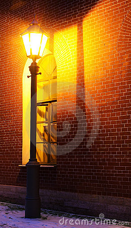 Lamp and brick wall