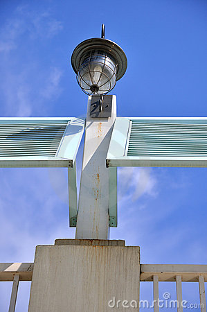 Lamp on construction under blue sky