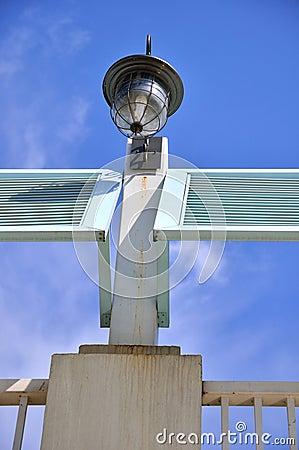 Lamp on construction under blue sky
