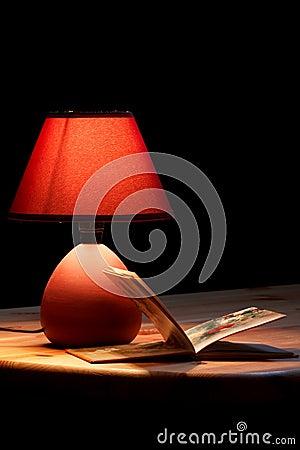 Lamp illuminating a book