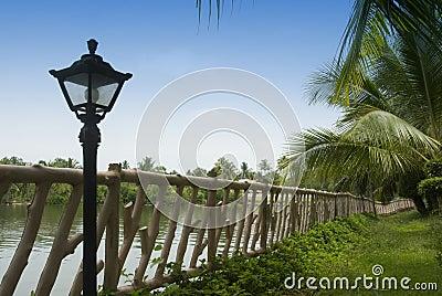 Lamp near a fence
