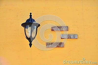 Lamp on orange wall