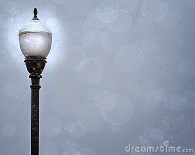 A lamp post in a snow storm