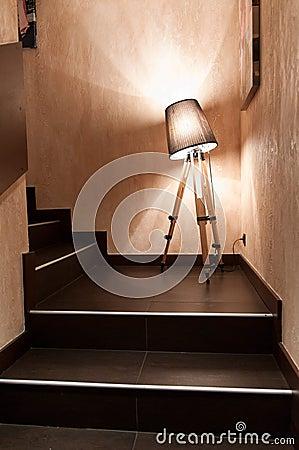 The lamp is between steps