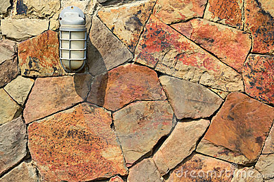 Lamp on stone wall