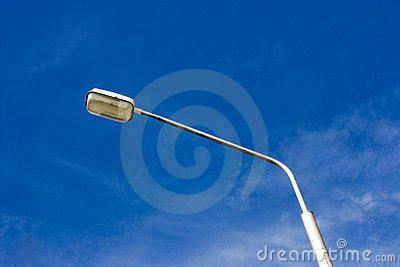 Lamppost against the sky