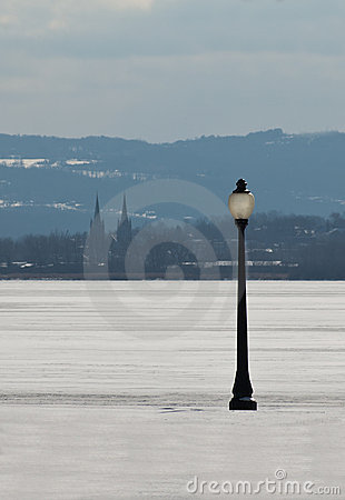 Lamppost and frozen lake
