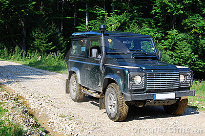 Land Rover on forest road