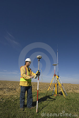 Land surveyor working with GPS