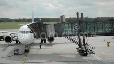 Landing on the plane. People pass through the jetbridge aboard an unrecognized airline. The concept of vacation and. Recreation. Slow Motion stock footage