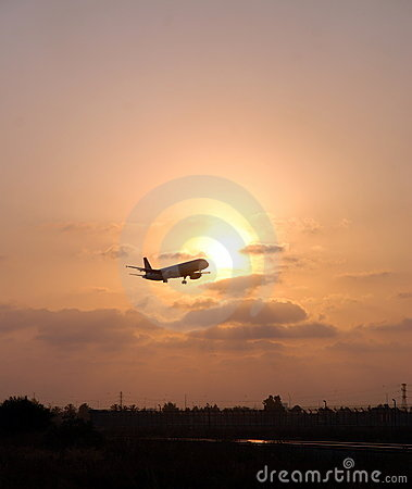 Landing plane on a sunset