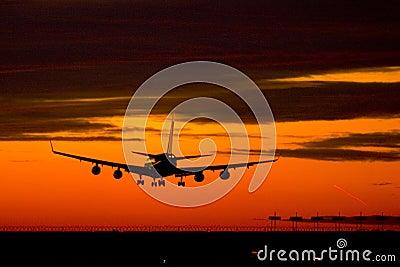 Landing plane on a sunset