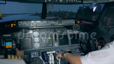 Landing training process held in a flight simulator  Modern passenger  airplane cabin interior