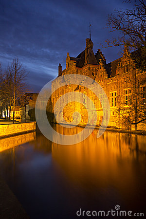 Landmarks from Bruges (Brugge) - Belgium - beautiful old house reflected canal waters by night