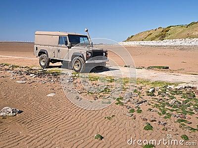 Landrover Jeep on Beach