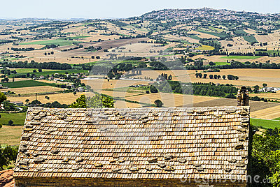 Landscape beyond a tiled roof